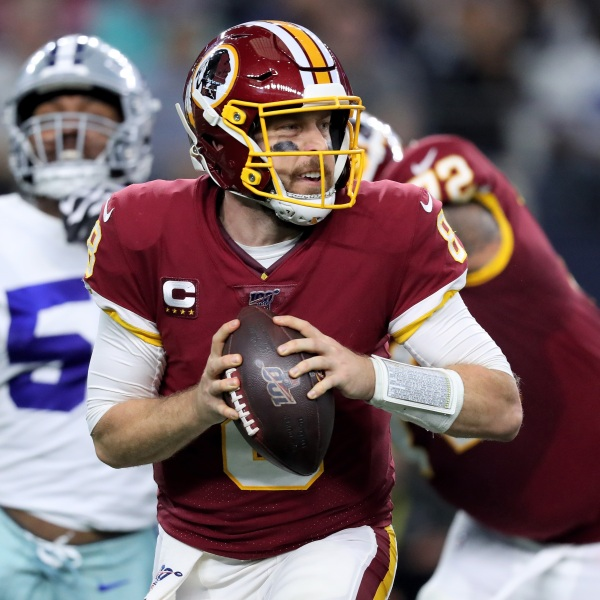 Case Keenum #8 of the Washington Redskins drops