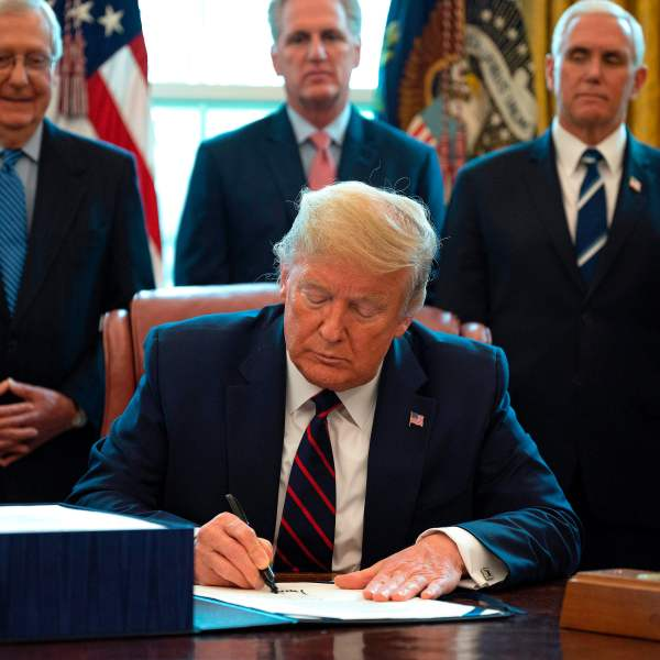 US President Donald Trump signs the CARES act