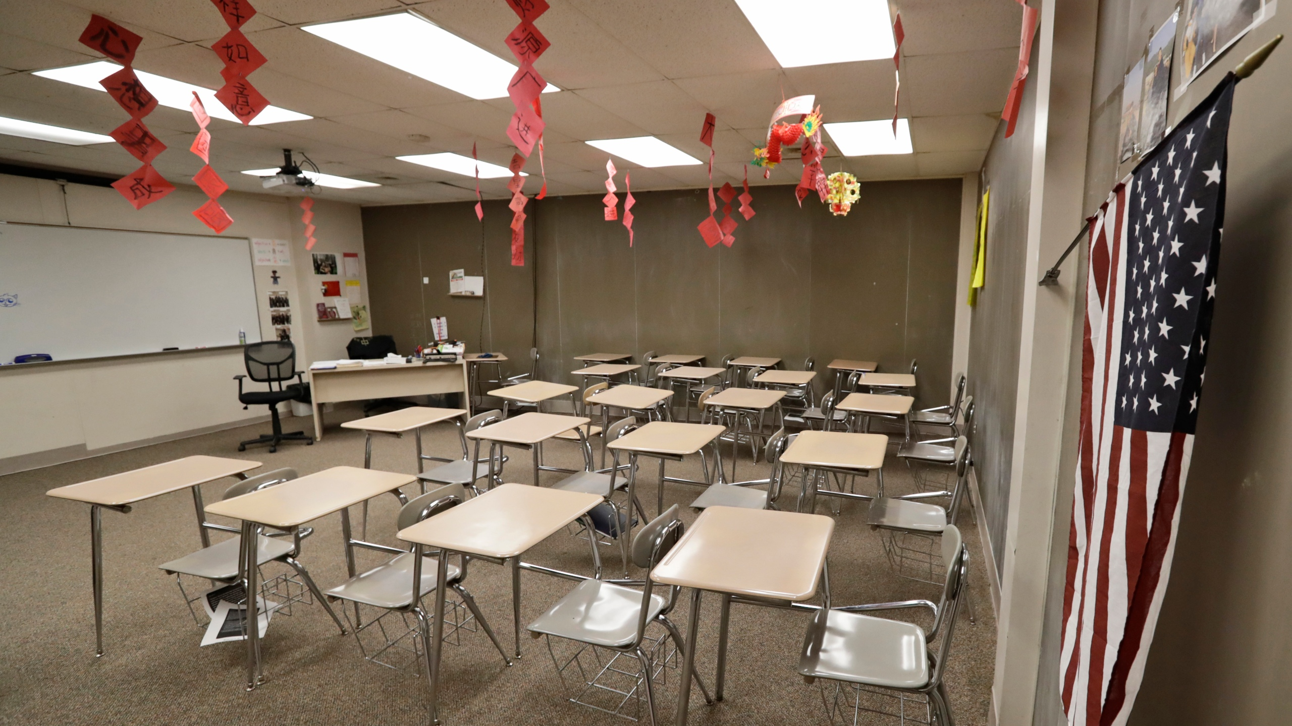The empty world language room is shown at Orange High School, Thursday, March 12, 2020, in Pepper Pike, Ohio. Gov. Mike DeWine ordered all schools closed for three weeks beginning Monday.