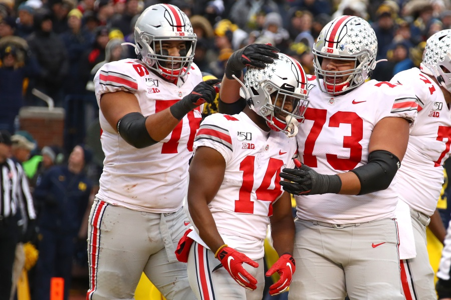 K.J. Hill #14 of the Ohio State Buckeyes celebrates his second half touchdown with Jonah Jackson