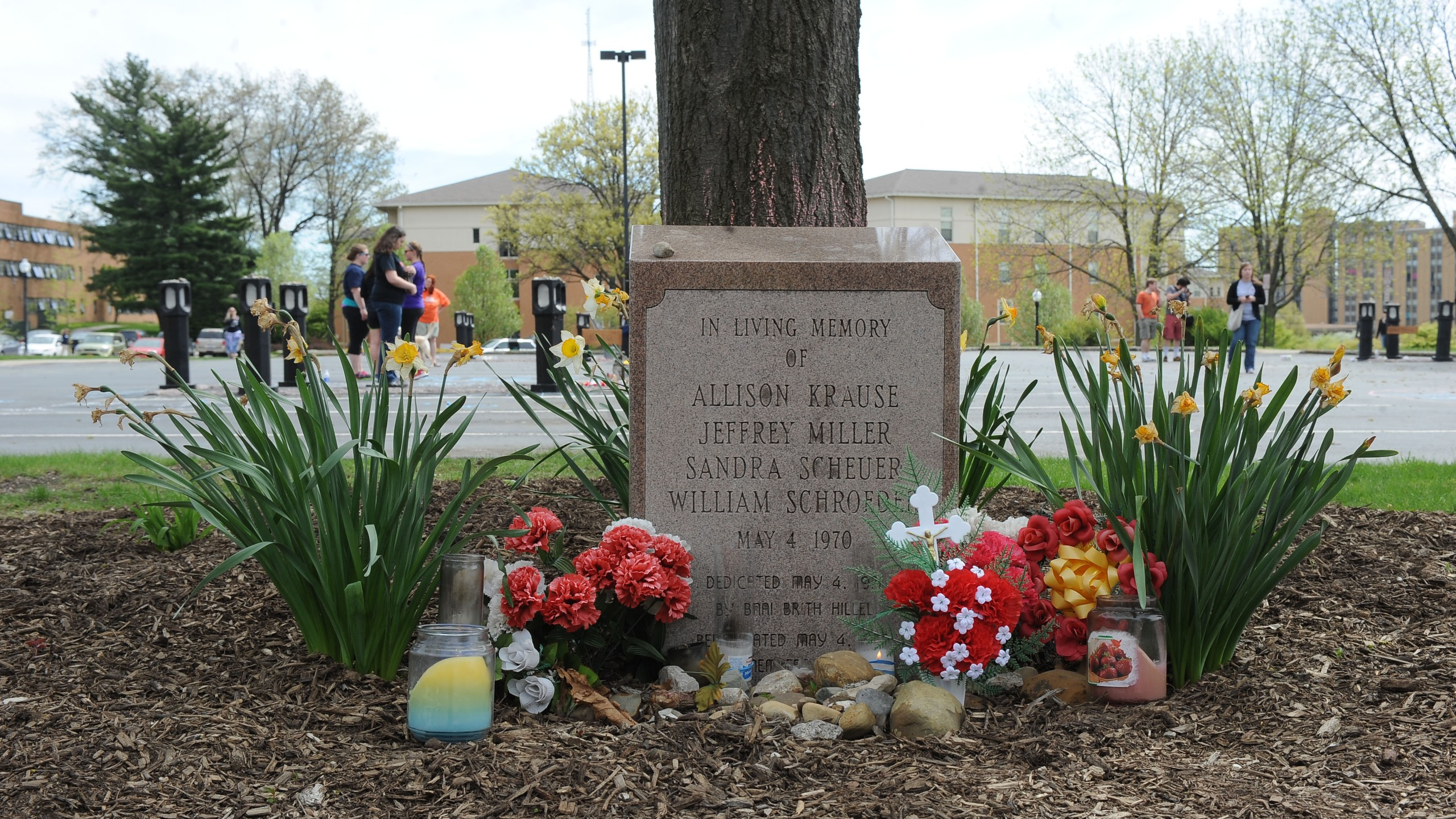 A marker to the four students who were killed on May 4, 1970 is surrounded by flowers