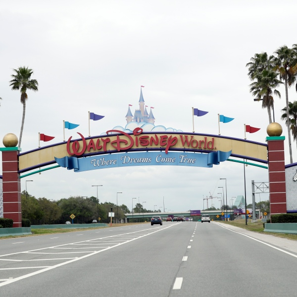 the road to the entrance of Walt Disney World has few cars, in Lake Buena Vista, Fla. Two more unions have reached agreements with Walt Disney World over furloughs caused by the theme park resort's closure