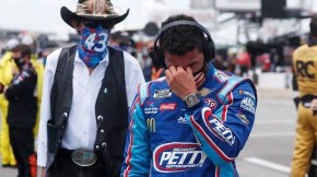 Driver Bubba Wallace, right, is overcome with emotion
