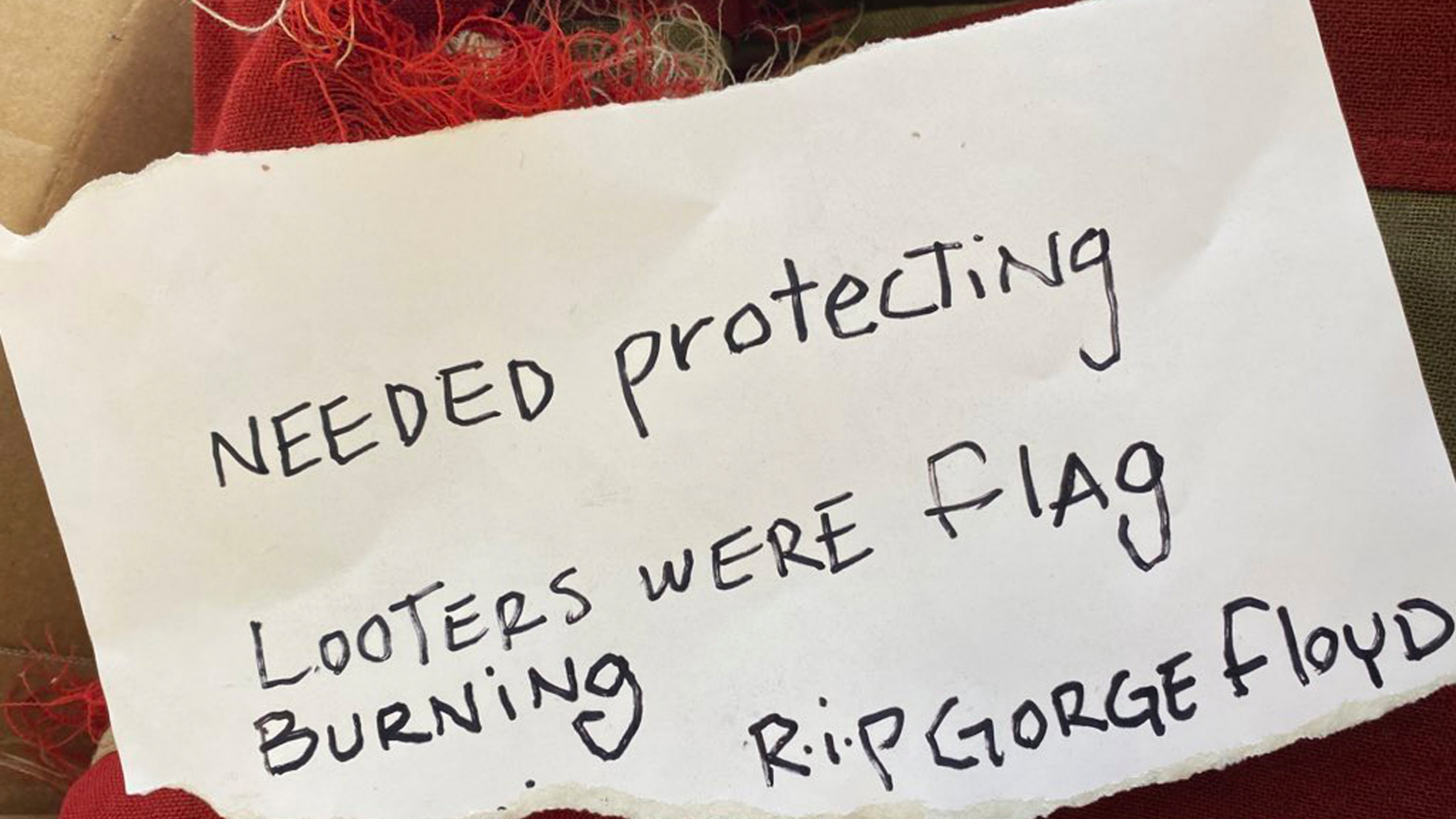 This photo provided by KRNV journalist Kenzie Margiott shows a note addressed to Margiott and a flag from a World War II