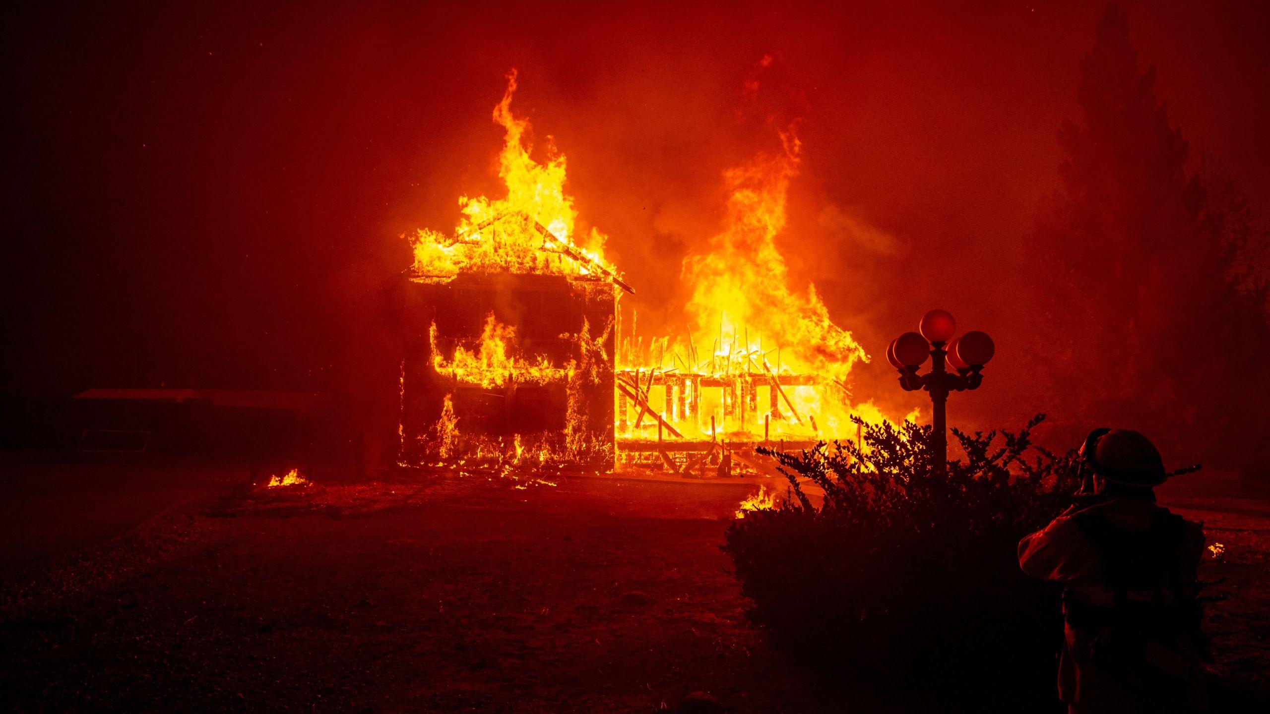 A home burns as the Camp fire tears through Paradise