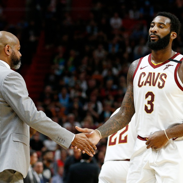 Andre Drummond #3 of the Cleveland Cavaliers high fives head coach J.B. Bickerstaff