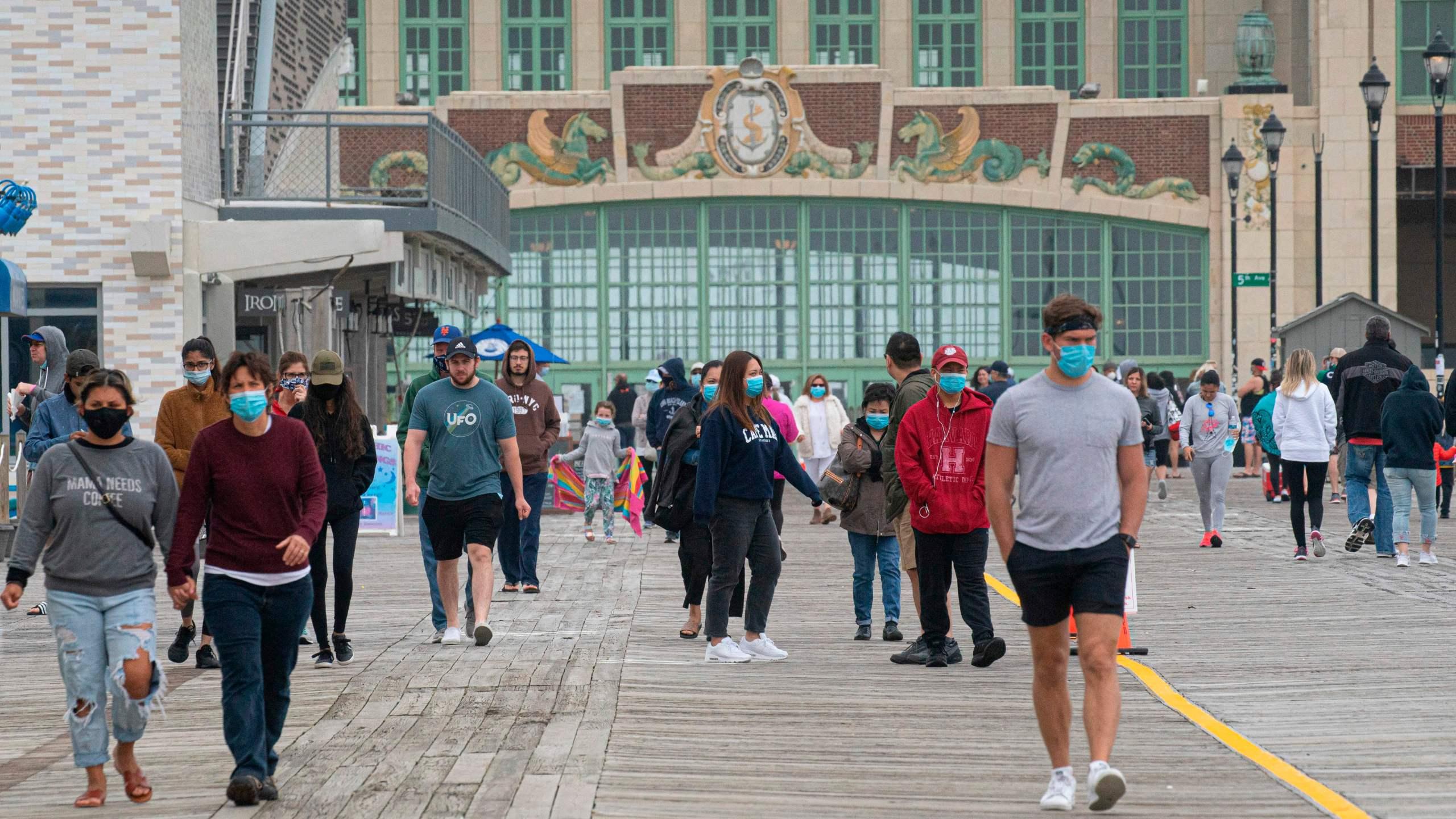 People walk by the boardwalk