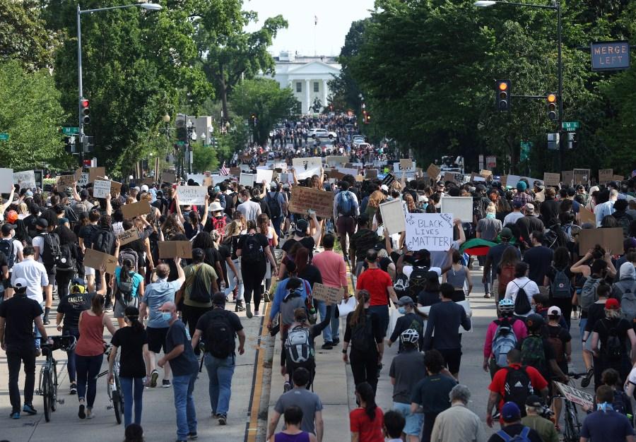 Hundreds of demonstrators march down 16th St toward Lafayette Park