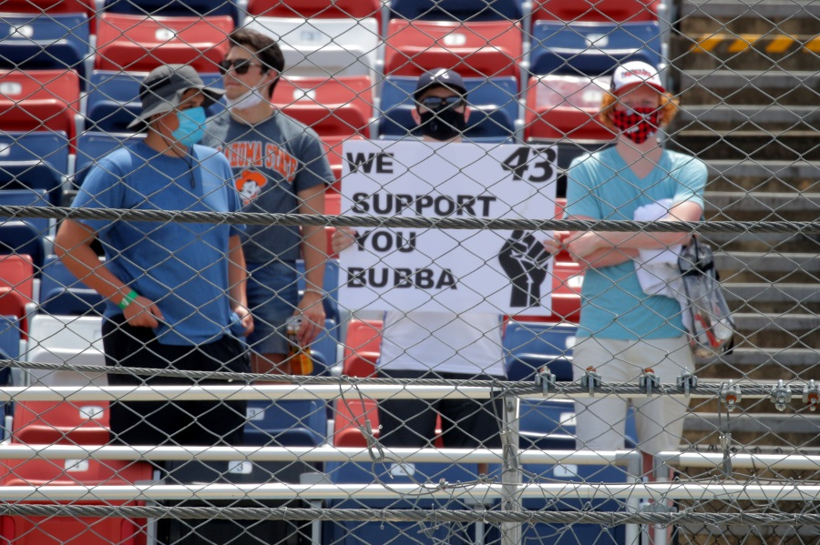 Fans hold a sign in support