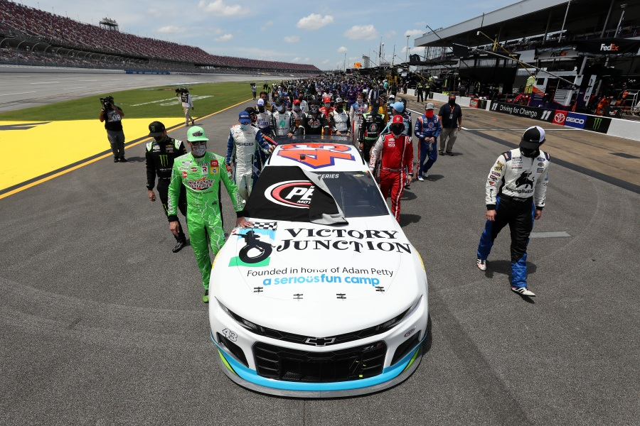 NASCAR drivers push the #43 Victory Junction Chevrolet