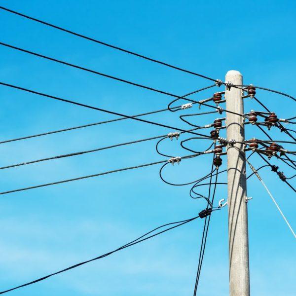 Power lines against blue sky