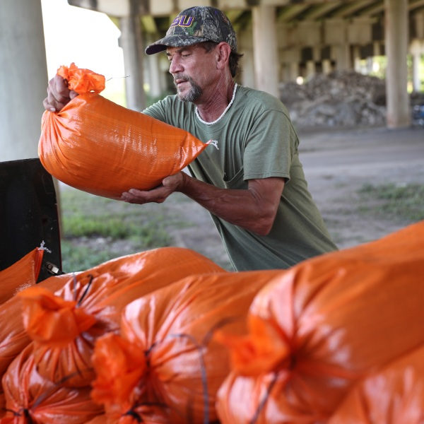 Ken Allen fills sandbags as he prepares for the arrival of Tropical Storm Marco and possibly Hurricane Laura on August 24, 2020 in Morgan City , Louisiana. The Gulf Coast is expecting to see some impact from Tropical Storm Marco followed by Hurricane Laura.