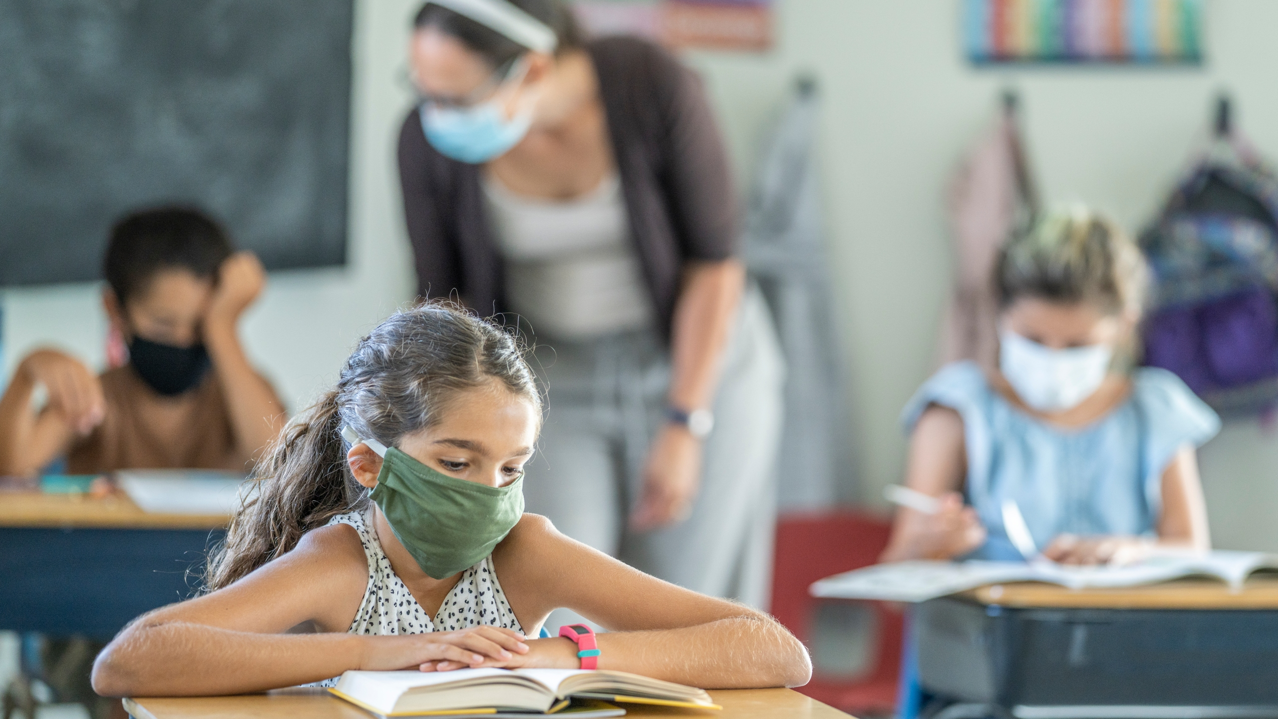 student wearing face mask in school