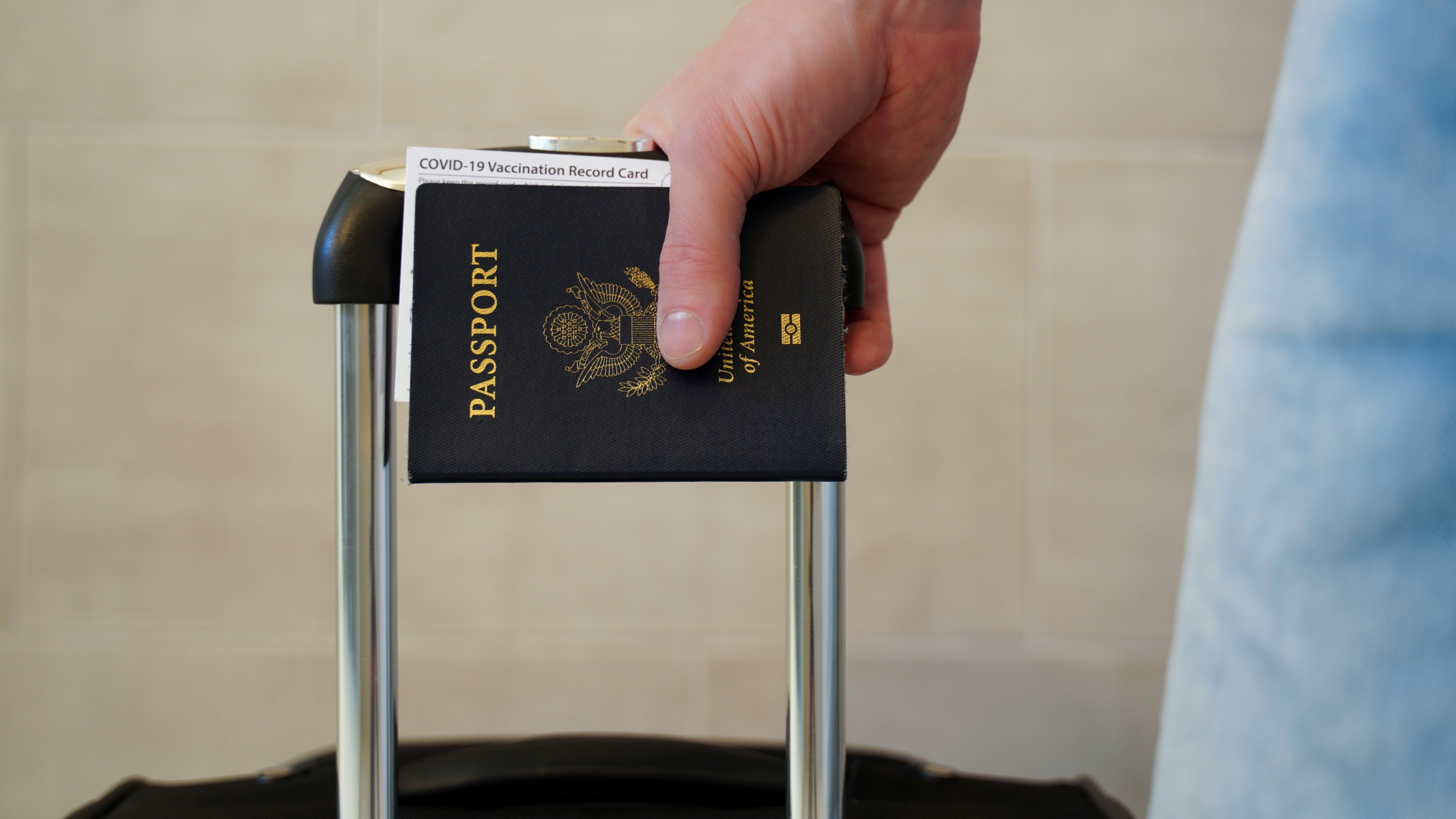 American passport with suitcase
