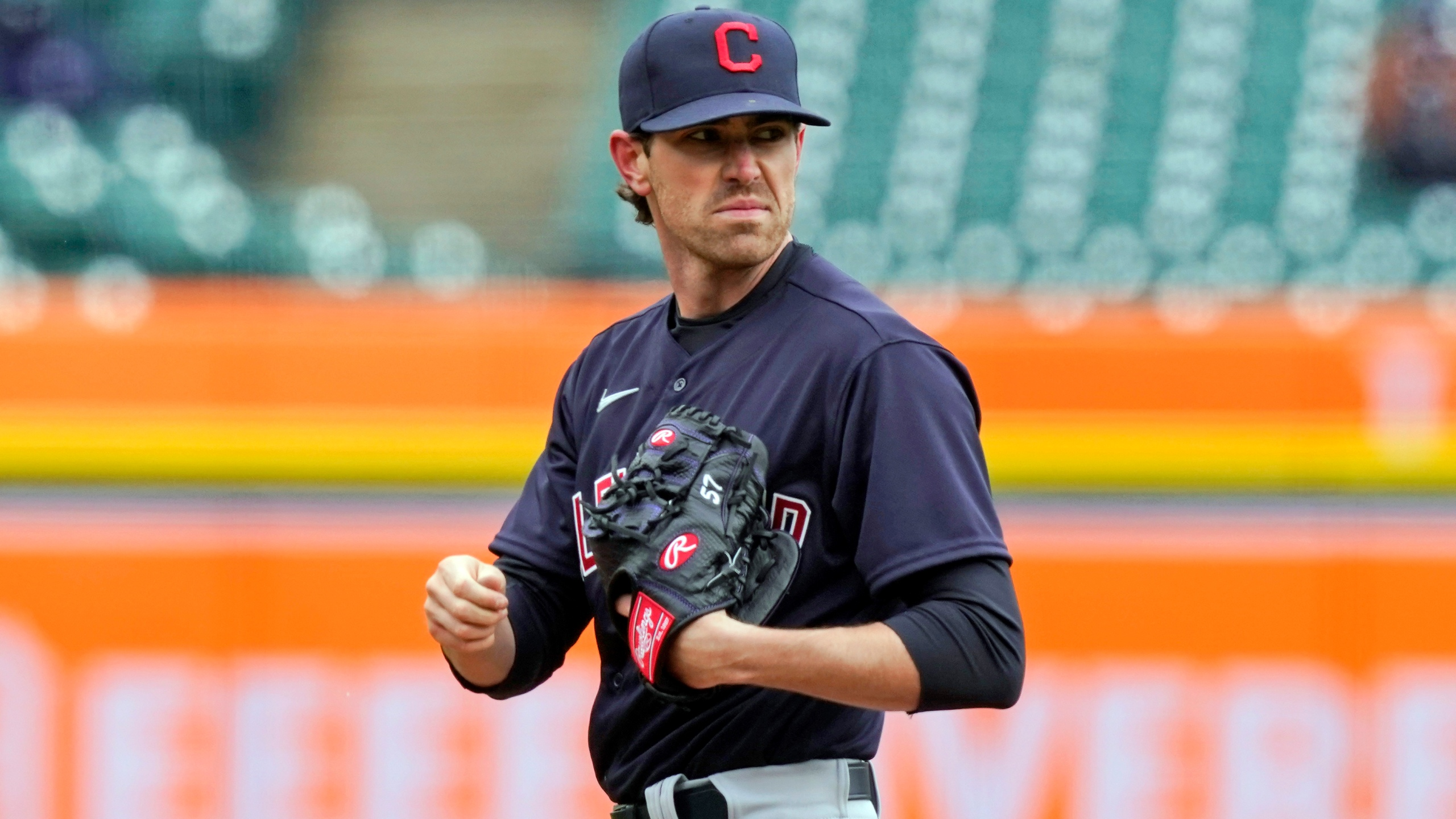 FILE - In this April 1, 2021, file photo, Cleveland Indians starting pitcher Shane Bieber looks towards first during the third inning of a baseball game against the Detroit Tigers, in Detroit. Cleveland's ace and the reigning AL Cy Young winner, who has been out with shoulder inflammation, was encouraged after throwing in the outfield Friday, Aug. 6, 2021, and said he wants to get back on the mound this season. (AP Photo/Carlos Osorio, File)