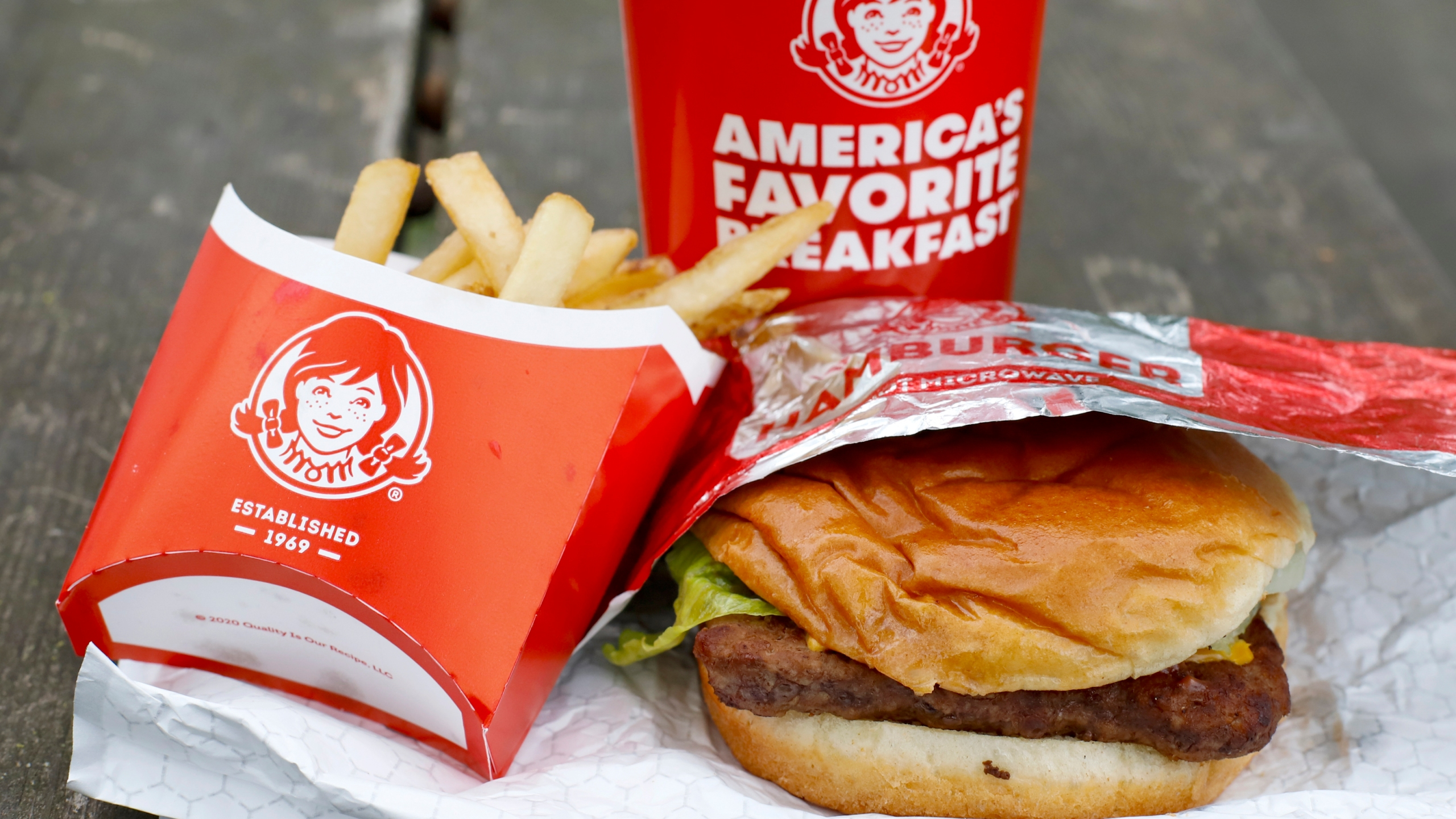 In this May 5, 2020, file photo, Wendy's restaurant Dave's Combo cheeseburger meal is displayed in Pittsburgh.