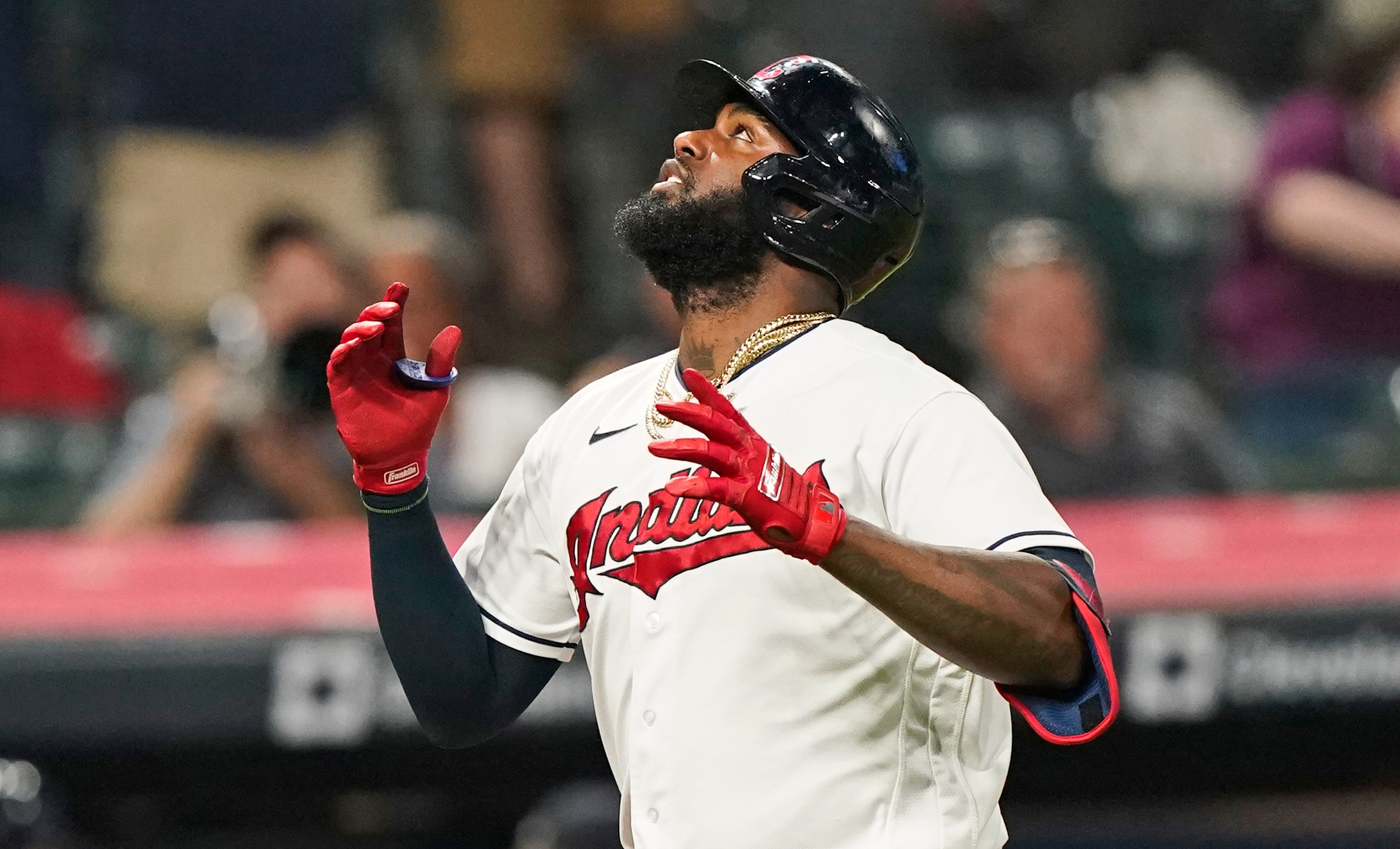 Cleveland Indians' Franmil Reyes looks up after hitting a solo home run during the seventh inning of the team's baseball game against the Texas Rangers, Wednesday, Aug. 25, 2021, in Cleveland. (AP Photo/Tony Dejak)