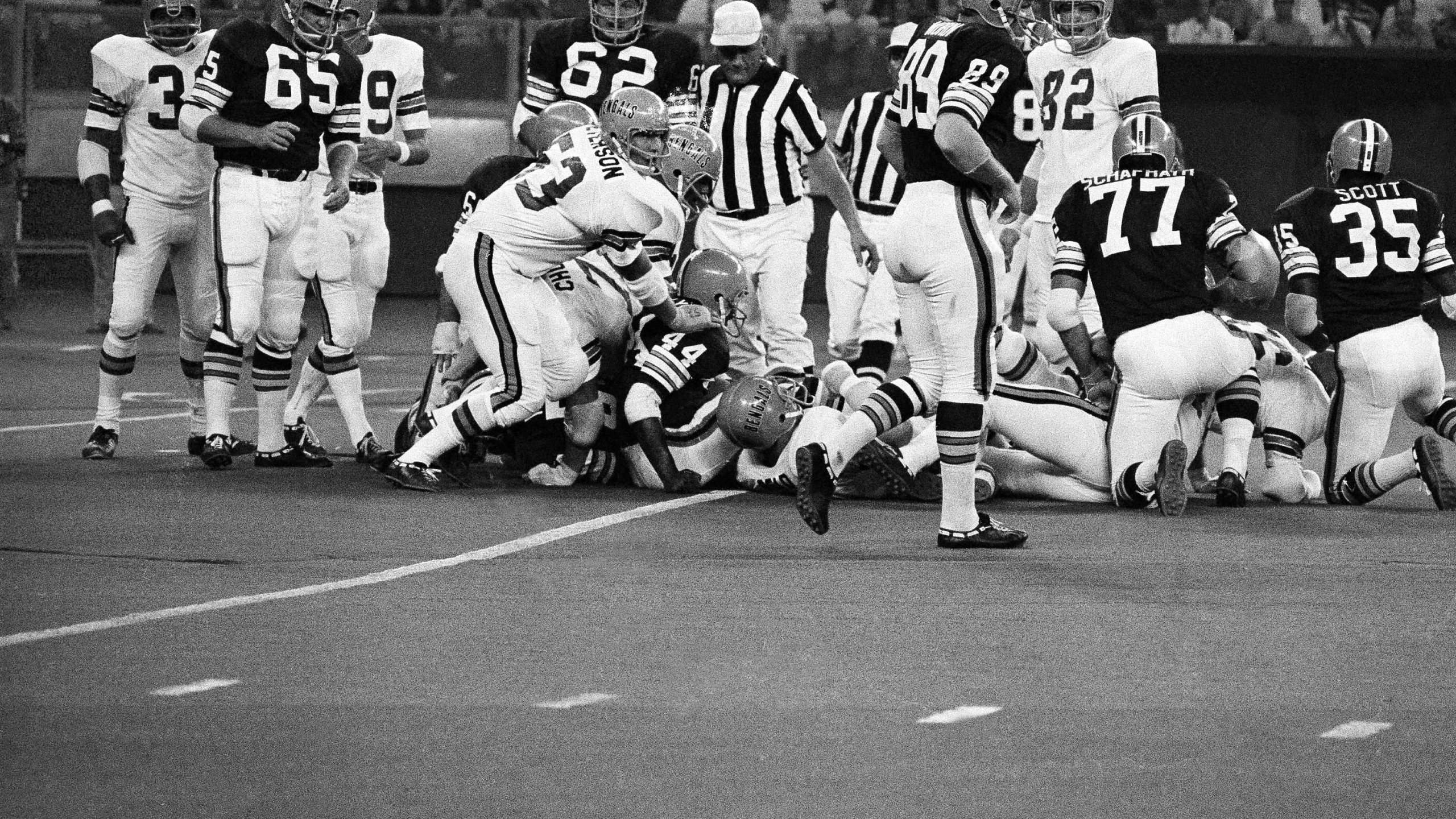Cleveland's Leroy Kelly tried an of tackle plunge against Cincinnati Bengals in a NFL exhibition game on Saturday, August 30, 1970in Cincinnati and was smothered by Bengals. Bengals stopping Kelly (arrow points to ball) were Mike Reid on ground to Kelly?s right, and Bill Peterson (53). Other Beowns are Joe Taffoni (62), Milt Morin (89) and Dick Schafrath (77). Bengals won, 31-24.