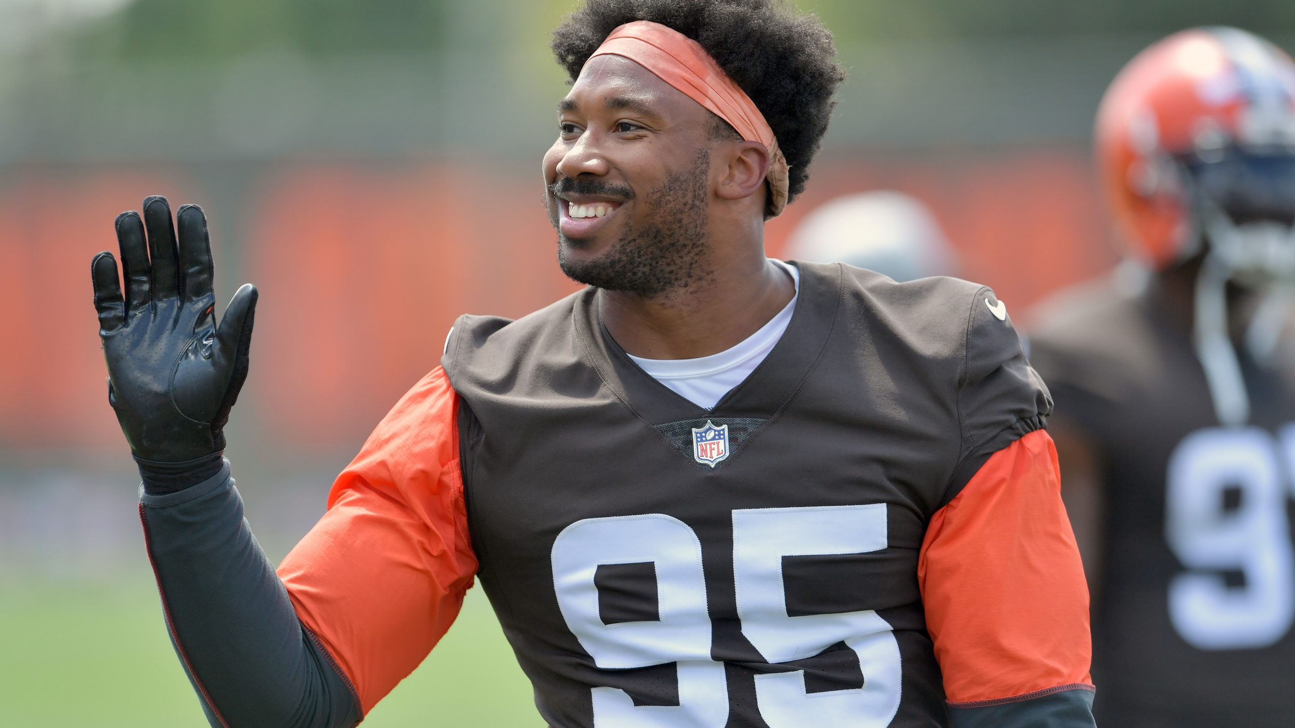 BEREA, OHIO - JULY 30: Defensive end Myles Garrett #95 of the Cleveland Browns waves to the fans during Cleveland Browns Training Camp on July 30, 2021 in Berea, Ohio. (Photo by Jason Miller/Getty Images)
