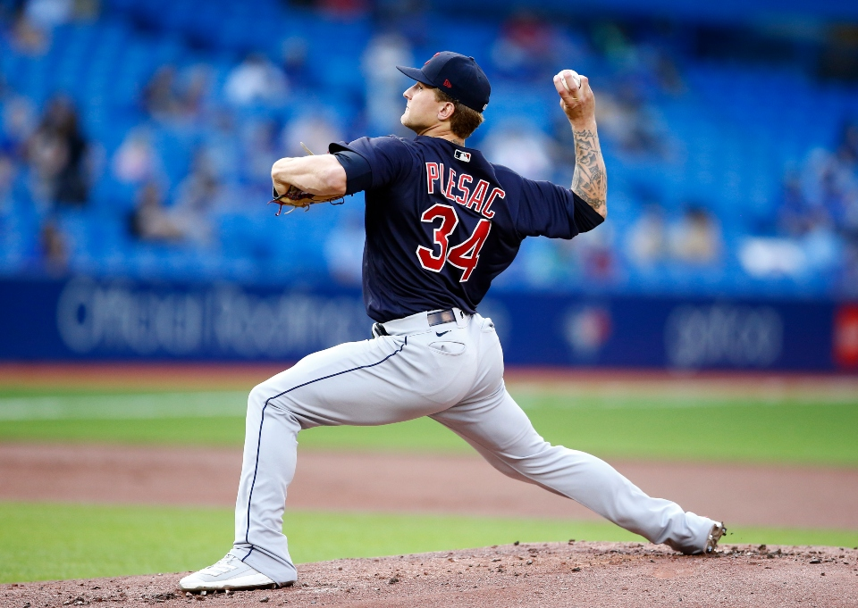 Zach Plesac #34 of the Cleveland Indians delivers a pitch in the first inning during a MLB game against the Toronto Blue Jays at Rogers Centre on August 03, 2021 in Toronto, Canada