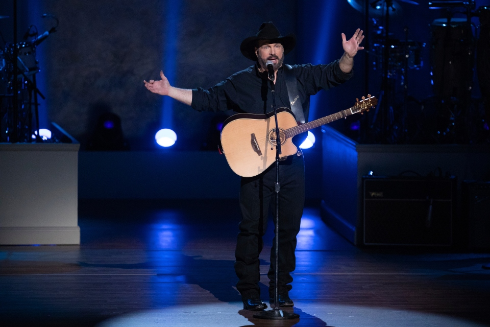 In this March 4, 2020, file photo, country star Garth Brooks performs on stage during the 2020 Gershwin Prize Honoree's Tribute Concert at the DAR Constitution Hall in Washington. Brooks said he will be reassessing whether to continue his stadium tour because of the rising number of COVID-19 cases.