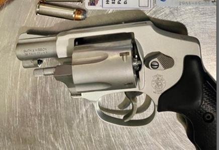 Hopkins International Airport, handgun seized