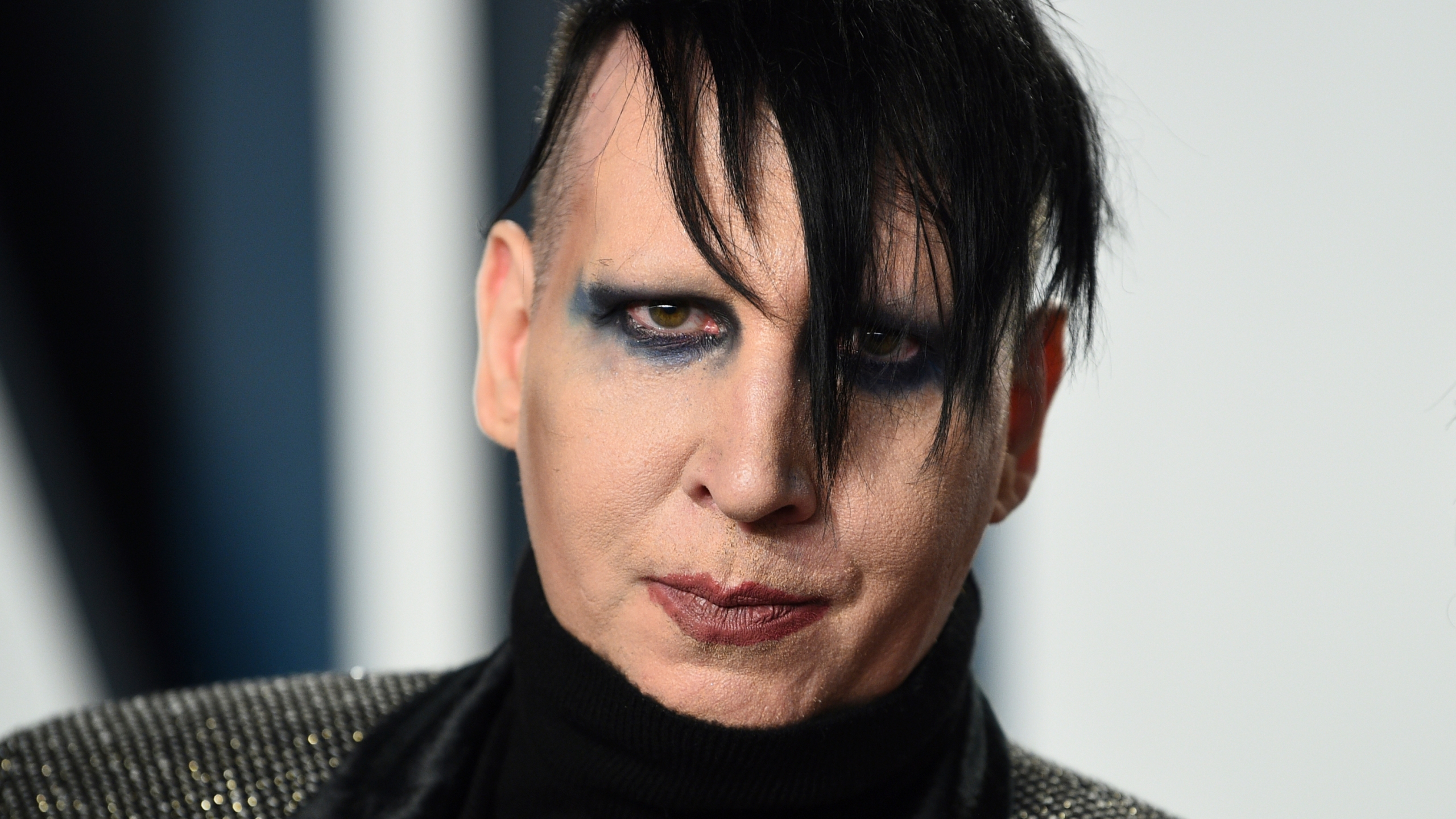 FILE - Marilyn Manson arrives at the Vanity Fair Oscar Party on Feb. 9, 2020, in Beverly Hills, Calif. An attorney has entered a not guilty plea on behalf Manson, who is accused of approaching a videographer at his 2019 concert in New Hampshire and allegedly spitting and blowing snot on her. A case status hearing is scheduled for Dec. 27. (Photo by Evan Agostini/Invision/AP, File)