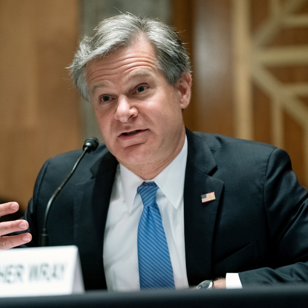 FBI Director Christopher Wray testifies before a Senate Homeland Security and Governmental Affairs Committee hearing to discuss security threats 20 years after the 9/11 terrorist attacks, Tuesday, Sept. 21, 2021 on Capitol Hill in Washington. (Greg Nash/Pool via AP)