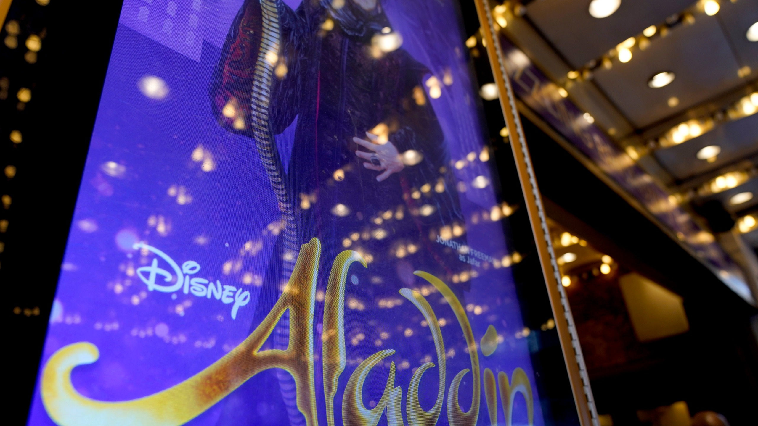 """A sign advertising the show """"Aladdin"""" is displayed in front of the New Amsterdam theater in New York, Thursday, Sept. 30, 2021. The hit Broadway show was canceled Wednesday night when breakthrough COVID-19 cases were reported within the musical's company, a day after the show reopened, a worrying sign for Broadway. (AP Photo/Seth Wenig)"""