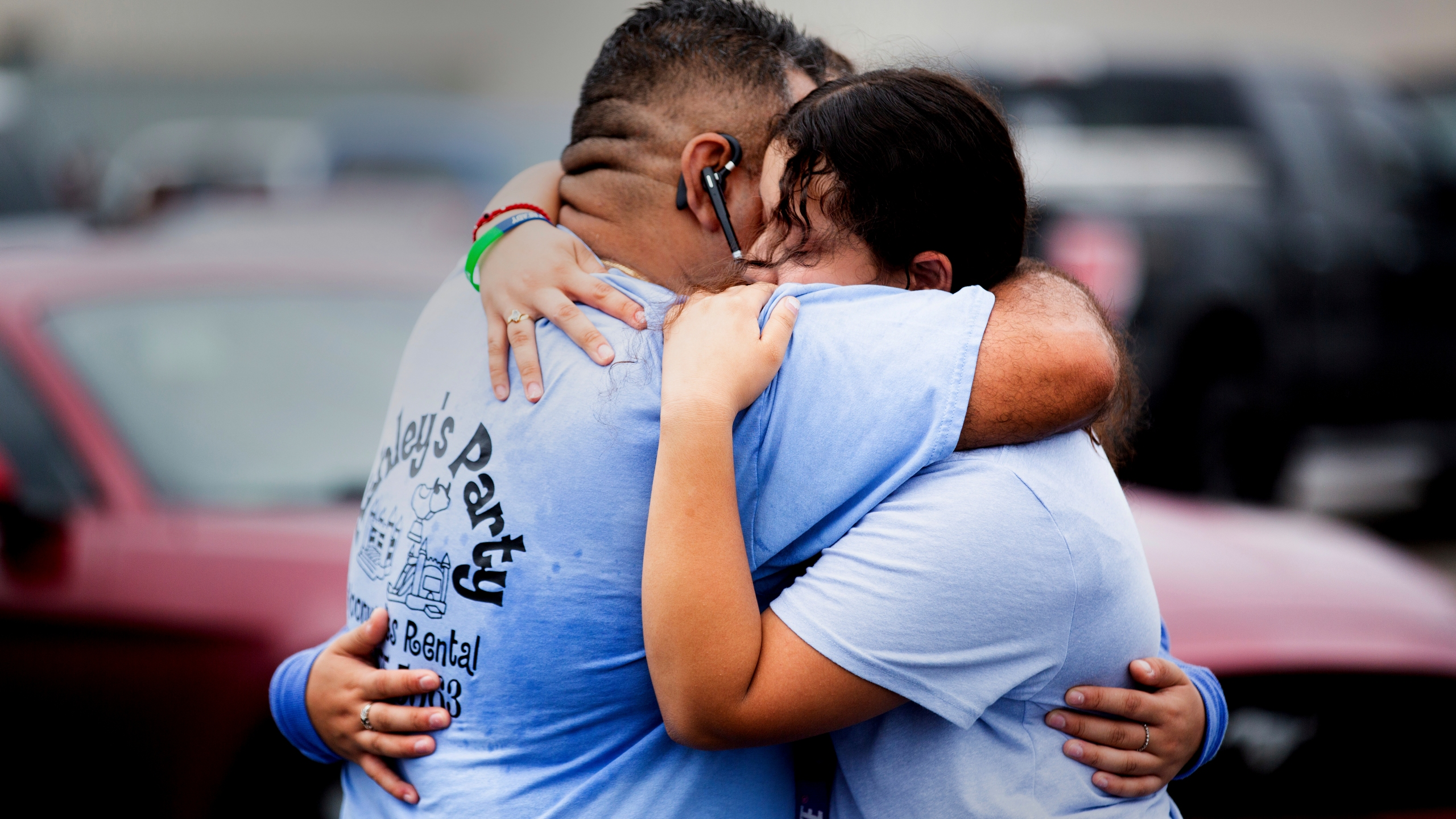 Yes Prep Southwest Secondary school 8th grader Kimberly Mendez, 14, right, to embrace her father Rudis and sister Ashley, 16, 11th grade, in a parking lot on the corner of Hiram Clarke Rd. and W. Fuqua St. after an alleged shooting took place at her school, YES Prep Southwest Secondary school, on Friday, Oct. 1, 2021, in Houston. An employee at the Houston charter school was shot and wounded by a former student, police said. Houston Police Chief Troy Finner said a 25-year-old man surrendered after being surrounded by police. (Marie D. De Jesús/Houston Chronicle via AP)