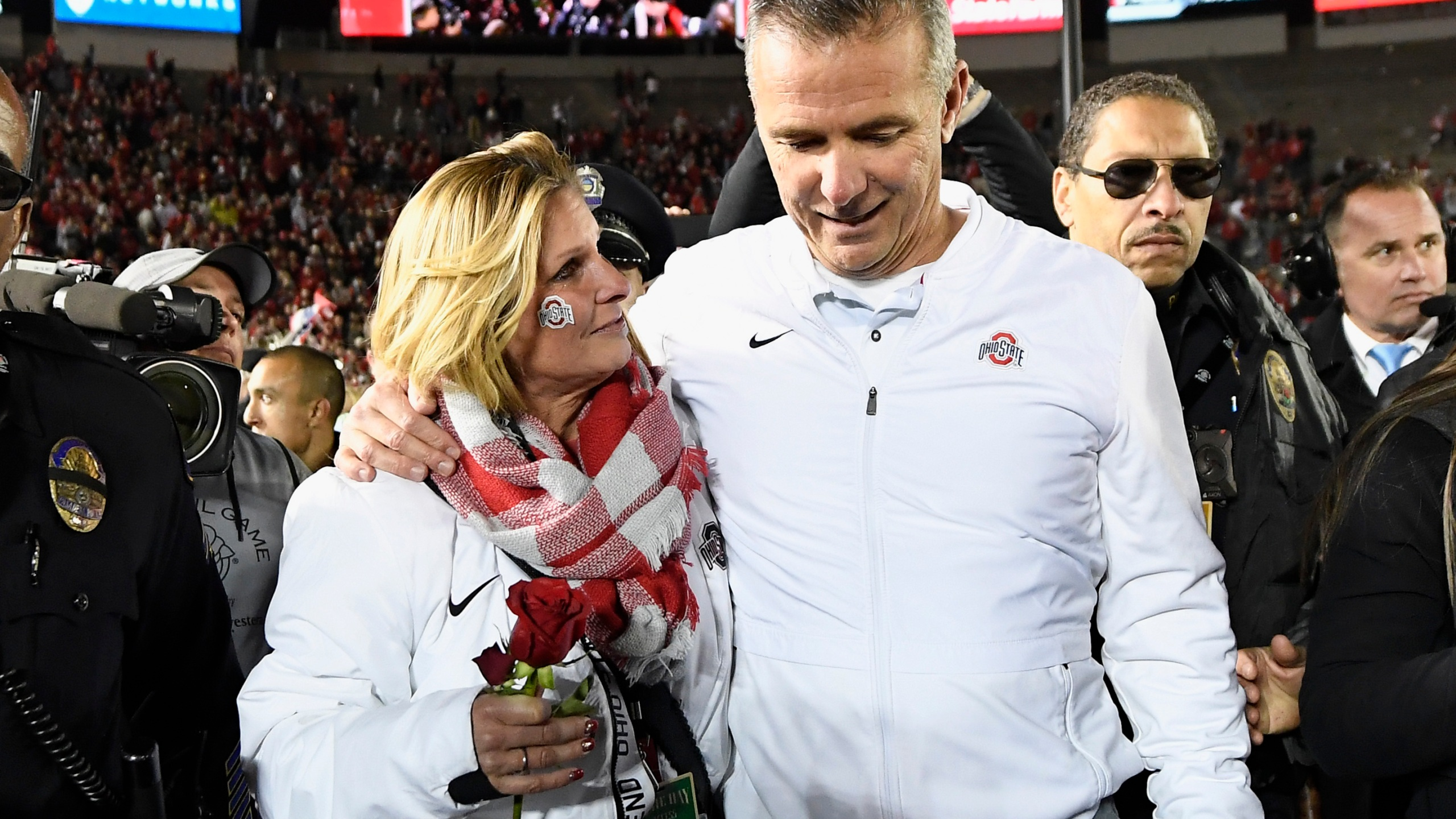 PASADENA, CA - JANUARY 01: Ohio State Buckeyes head coach Urban Meyer and wife Shelley Meyer celebrate after the Ohio State Buckeyes win the Rose Bowl Game presented by Northwestern Mutual at the Rose Bowl on January 1, 2019 in Pasadena, California. (Photo by Kevork Djansezian/Getty Images)